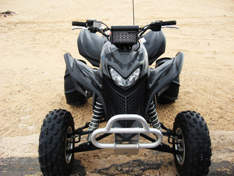 Black ATV Reppin' a Rigid Handle Bar Mount & E-Series Light Bar!