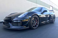 Ida's Sharkafied Porsche Cayman GT4 on Forgeline One piece Forged Monoblock GA1R Open Lug Wheels
