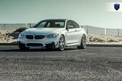 BMW M4 - White Driver Side Front Angle