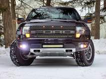 Black Ford Raptor out in the Snow for some donuts!