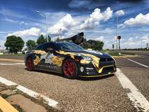 Pennzilla Nissan GT-R on Transparent Red Forgeline GA1R Wheels