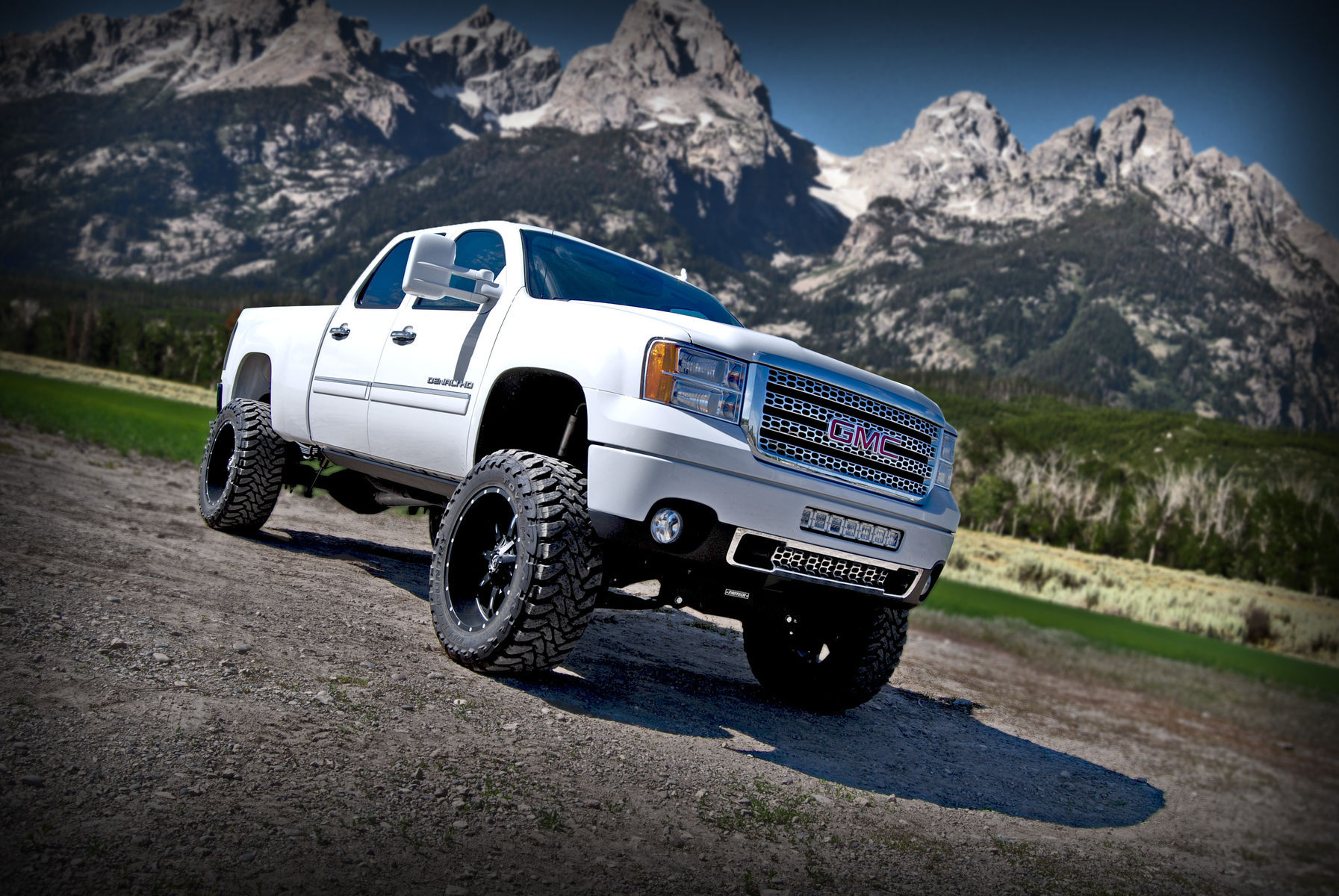 GMC  | White GMC 2500 with Rigid Industries D-Series lights