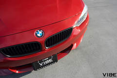 2014 Red BMW 435i equipped with Rohana wheels and lowered on H&R Springs - Bimmer Emblem