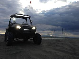 All-Black Polaris RZR with Rigid lights
