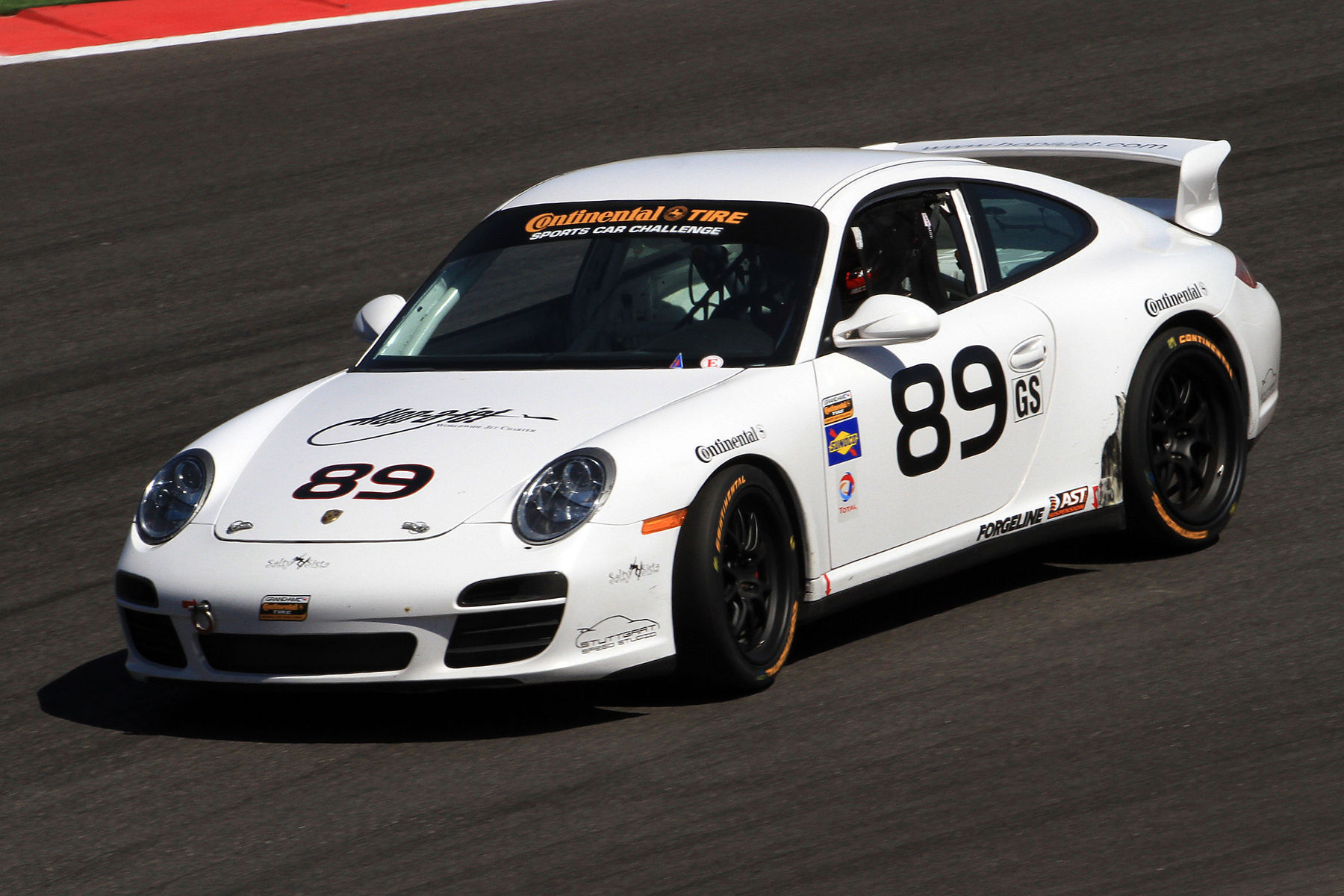 | Style, precision and speed are what makes up the 89 Porsche, maneuvering the COTA track on their Continental Tires.