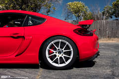 SP Motorsports' Porsche Cayman GT4 Shop Car on Forgeline One Piece Forged Monoblock GA1R Open Lug Wheels