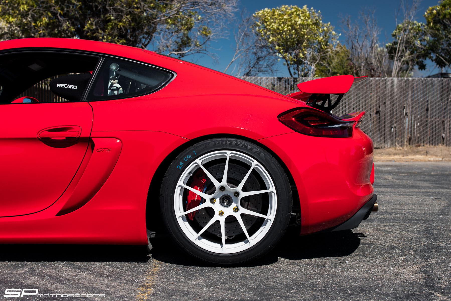 2016 Porsche Cayman | SP Motorsports' Porsche Cayman GT4 Shop Car on Forgeline One Piece Forged Monoblock GA1R Open Lug Wheels