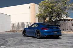 Sapphire Blue Porsche Cayman GT4 on Satin Black Forgeline One Piece Forged Monoblock GS1R Wheels