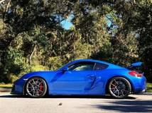Blue Porsche Cayman GT4 on Forgeline One Piece Forged Monoblock GS1R Wheels