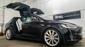 Tesla Model X in the shop for XPEL ULTIMATE clear bra