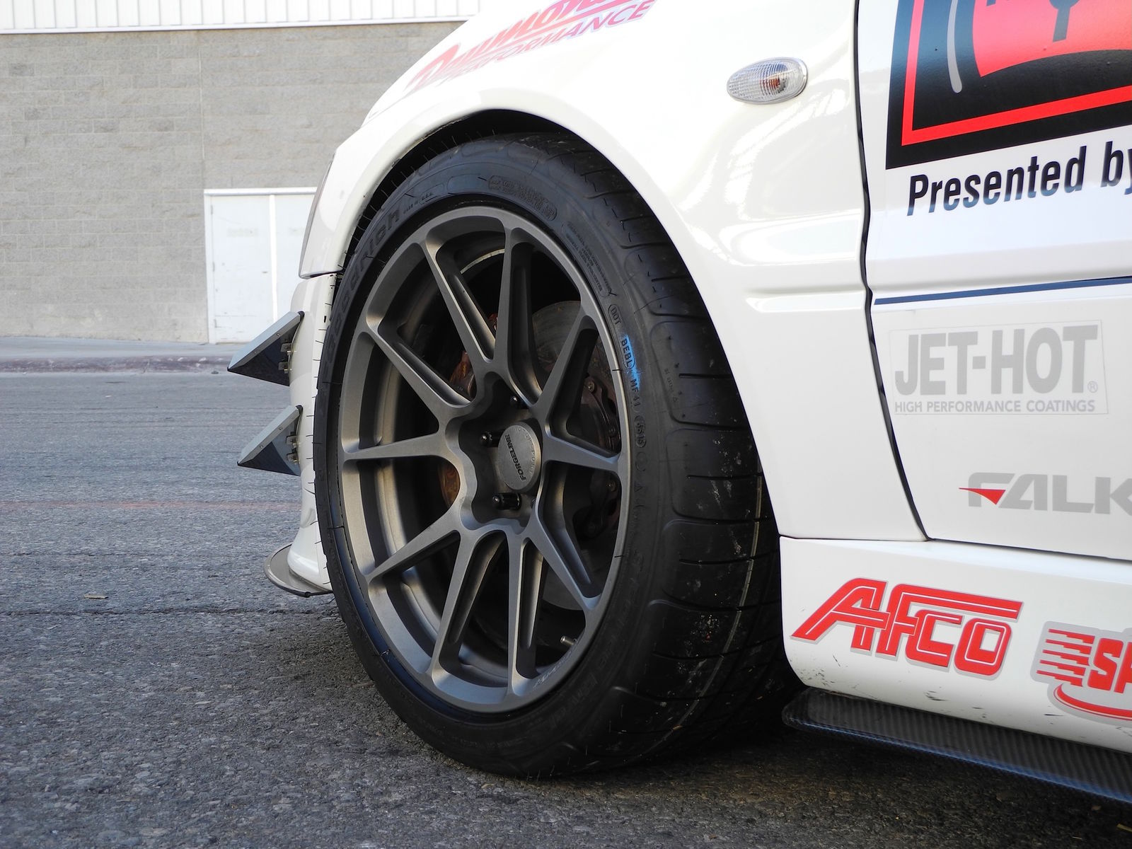 2006 Mitsubishi Lancer Evolution | Showtime Motorsports Evo on Forgeline GA1R Open Lug Wheels - Close Up Wheel Shot