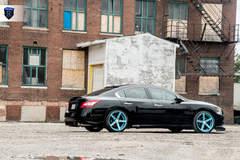 Black Nissan Maxima - Side Wheel Shot