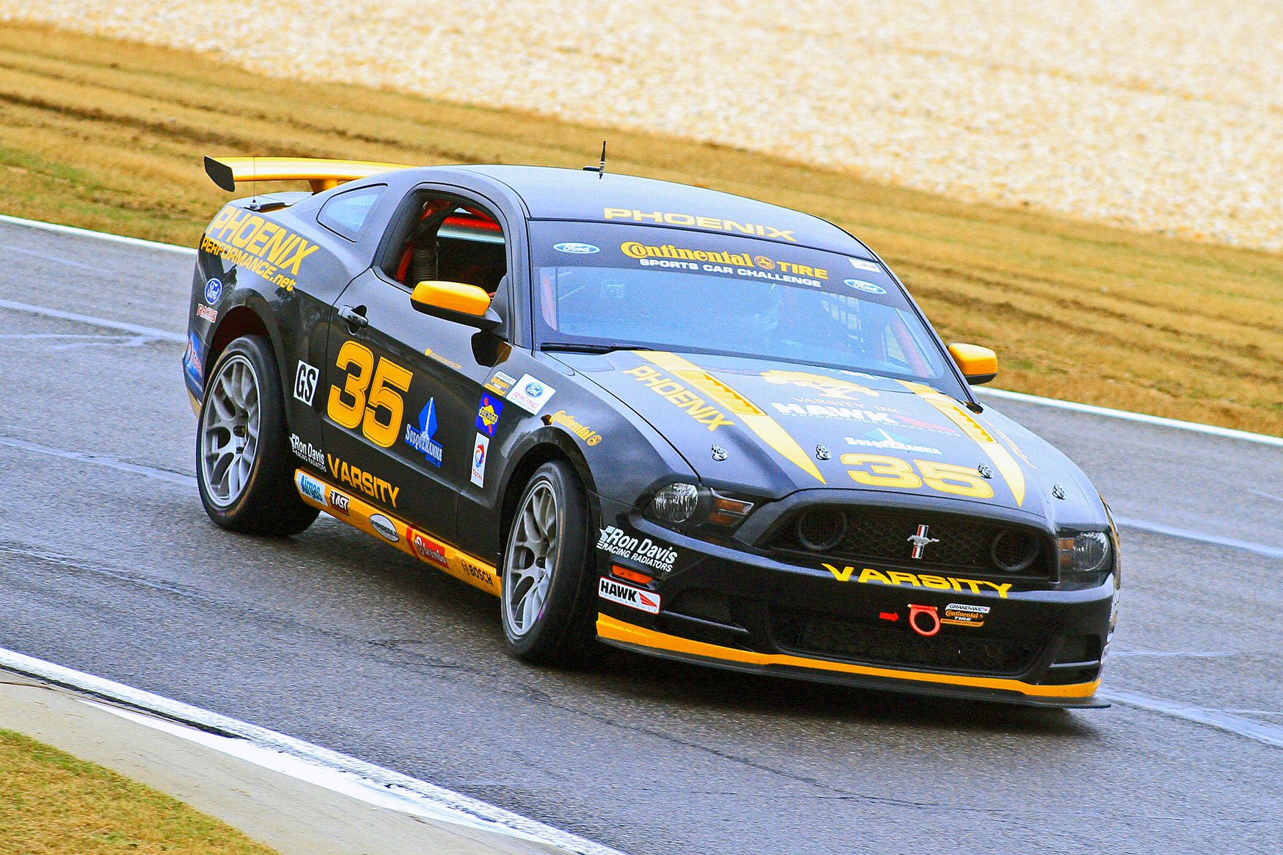 | Downhill turning into the apex at Barber Motorsports Park on their fresh Continental Tires.