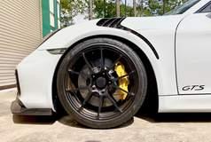 BGB Motorsports' Porsche Cayman GT4RS on Forgeline One Piece Forged Monoblock GA1R Open Lug Wheels