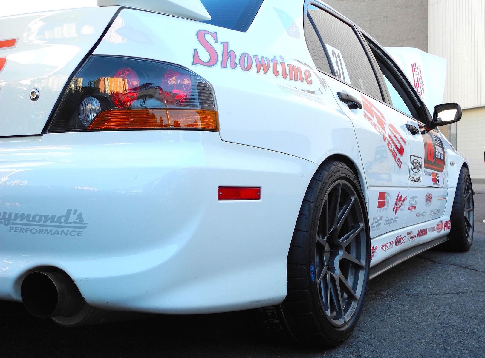 2006 Mitsubishi Lancer Evolution | Showtime Motorsports Evo on Forgeline GA1R Open Lug Wheels - Low Wheel View
