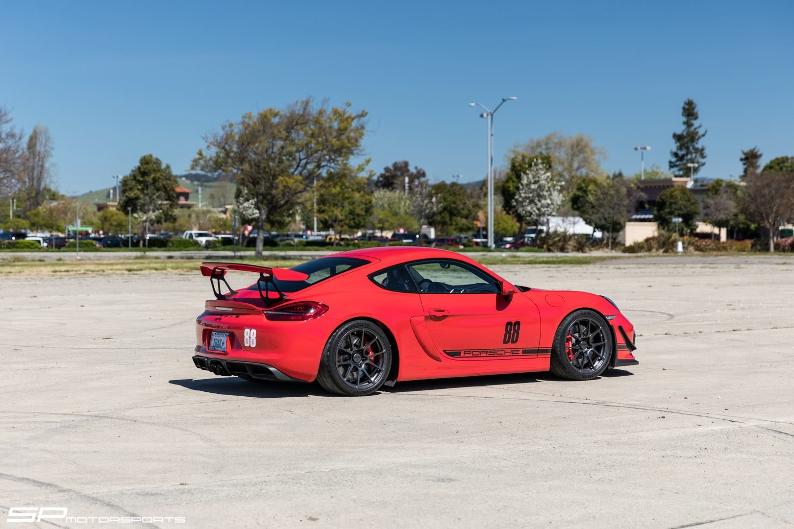 2016 Porsche Cayman | Steve's SP Motorsports Guards Red Porsche Cayman GT4 on Forgeline One Piece Forged Monoblock GA1R Open Lug Wheels