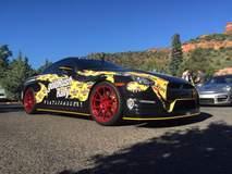 Pennzilla Nissan GT-R on Transparent Red Forgeline GA1R Wheels