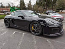 Sharkified Porsche Cayman GT4 on Forgeline One Piece Forged Monoblock GA1R Open Lug Wheels