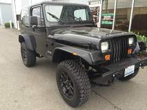 '90 YJ Jeep with lift, wheels, and custom bumper and fenders