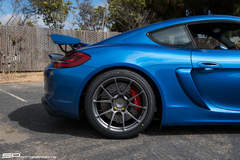 Sapphire Blue Porsche Cayman GT4 by SP Motorsports on Forgeline One Piece Forged Monoblock GS1R Wheels