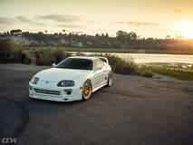 Single Turbo White Toyota Supra MKIV - CCW D110 Copper Wheels