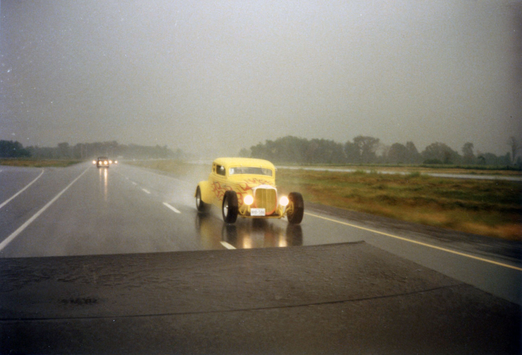 1933 Ford  | All-steel 1933 Ford Coupe driving in the rain