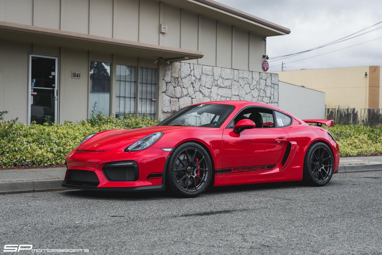 2016 Porsche Cayman | Steve's Guards Red Porsche Cayman GT4 on Forgeline One Piece Forged Monoblock GA1R Open Lug Cap Edition Wheels