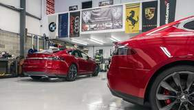 Two Red Tesla Model S with XPEL Clear Bra