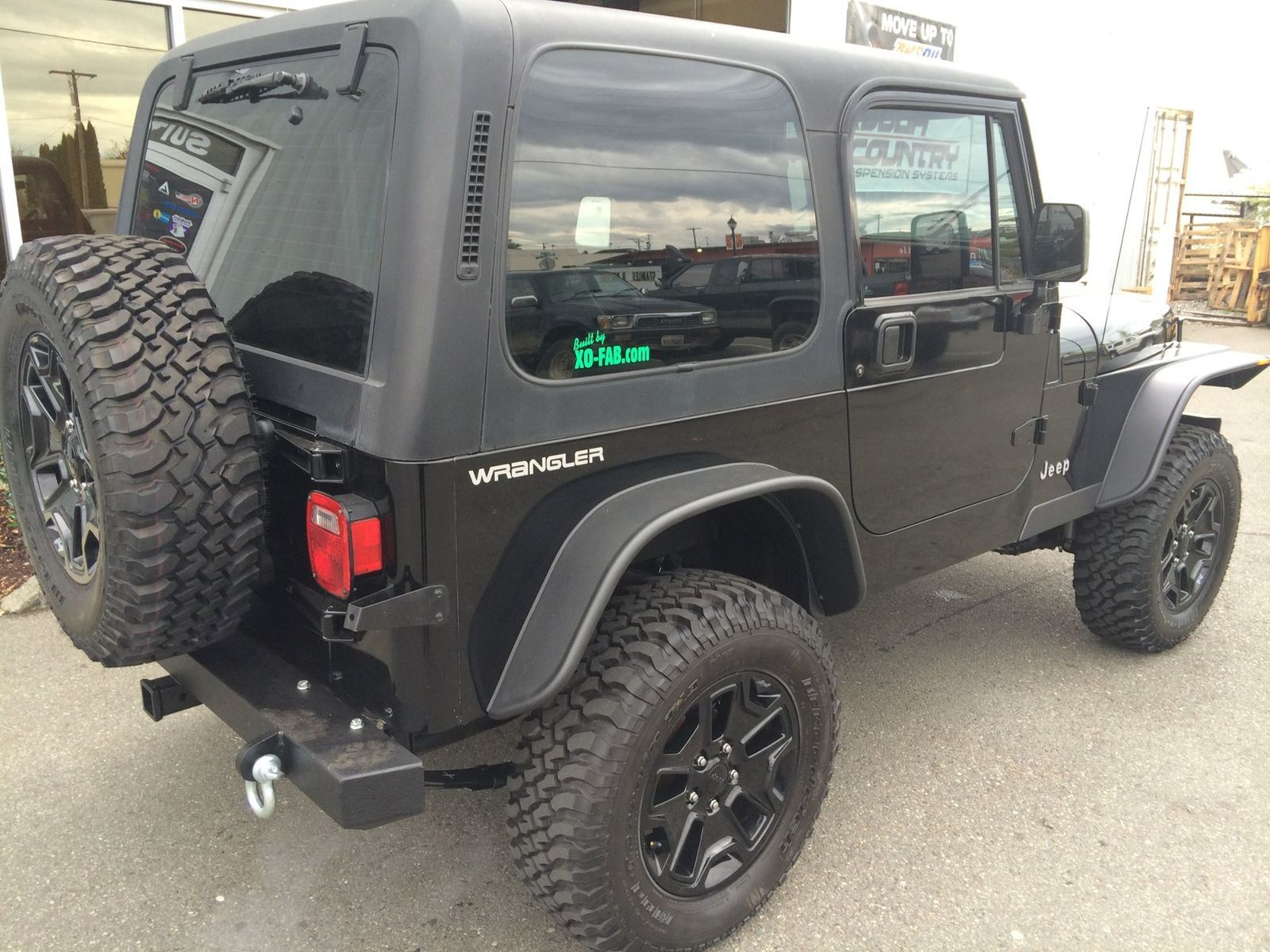 1990 Jeep Wrangler   '90 YJ Jeep with lift, wheels, and custom bumper and fenders