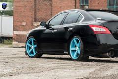 Black Nissan Maxima - Side Stance