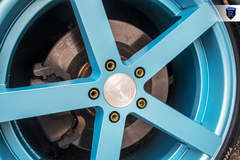 Black Nissan Maxima - Blue Spokes