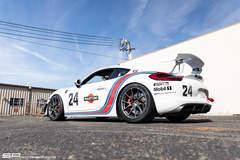 Lar's SP Motorsports Martini Livery Porsche Cayman GT4 on Forgeline One Piece Forged Monoblock GS1R Wheels