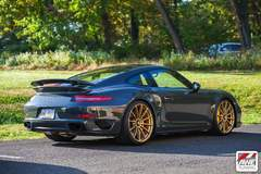 AWE Tuning's 2015 Porsche 991 TTS on Forgeline One Piece Forged Monoblock GT1 Wheels in Satin Gold