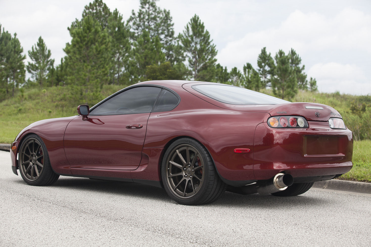 1997 Toyota Supra | Titan Motorsports Ruby Red MKIV Toyota Supra on Forgeline RB3C Concave Wheels